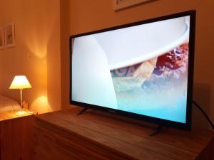 Una televisión o centro de entretenimiento en B3 Apartments