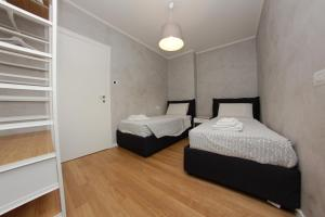 A bed or beds in a room at Be Apartments Brembo