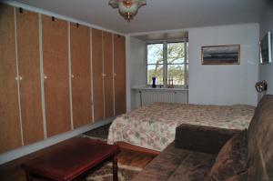 Säng eller sängar i ett rum på Nickarve Gård