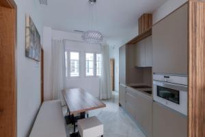 Casa Gloria Apartmentsにあるキッチンまたは簡易キッチン