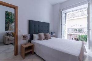 Casa Gloria Apartmentsにあるベッド