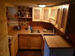 Kuchyň nebo kuchyňský kout v ubytování Chata Námestovo, Centrum