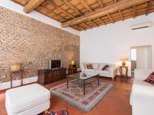 Coin salon dans l'établissement RSH Spanish Steps Apartments