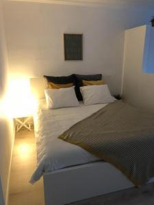 מיטה או מיטות בחדר ב-Studio Ostend Living