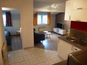 A kitchen or kitchenette at Location Appartement courte durée