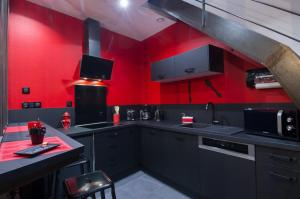 Cuisine ou kitchenette dans l'établissement Béthune appart'hôtel