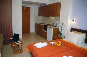 Η κουζίνα ή μικρή κουζίνα στο Aria Hotel Samos Town