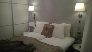 Voodi või voodid majutusasutuse Piriko Apartments toas