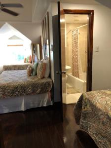 Cama ou camas em um quarto em The Oasis Retreat