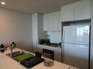 A kitchen or kitchenette at Sydney Olympic Park Apartment