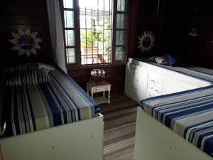 A bed or beds in a room at Chalé da Lucimar