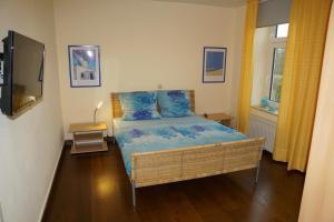 Ein Bett oder Betten in einem Zimmer der Unterkunft Villa Wilhelmina