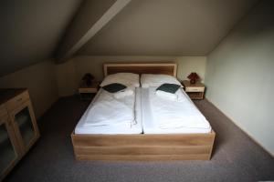 Posteľ alebo postele v izbe v ubytovaní Cassovia Apartments