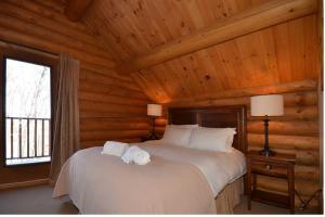 A bed or beds in a room at Chalet Elki