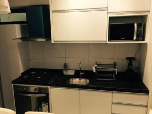 A kitchen or kitchenette at Flat Rosarinho Prince Premium