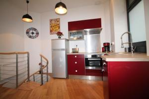 A kitchen or kitchenette at Cozy Saint Georges