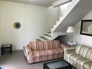 Zona de estar de Casa Confortavel em Floripa