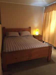 Cama o camas de una habitación en departamento en ñuñoa