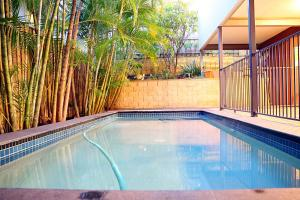 The swimming pool at or near Spacious House in Heart of Surfers Paradise