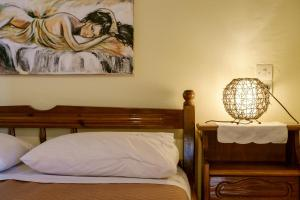 A bed or beds in a room at Seafront Paradise