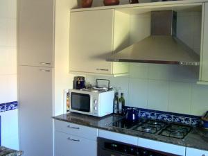 A kitchen or kitchenette at El Llanillo