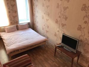 Кровать или кровати в номере Kvartira on Pereulok Sadovy 9
