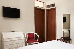 A television and/or entertainment center at LHP Suite Rivisondoli
