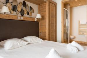 Ένα ή περισσότερα κρεβάτια σε δωμάτιο στο Chalet des Neiges Koh-i Nor
