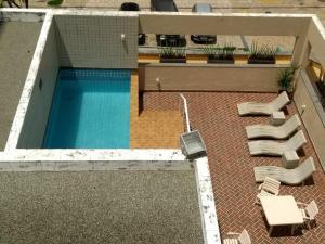 A view of the pool at Apartamento/Flat na Ponta da Areia (Praia) por Temporada or nearby