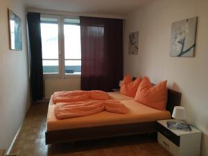 Ein Bett oder Betten in einem Zimmer der Unterkunft Salzburg Apartments Business