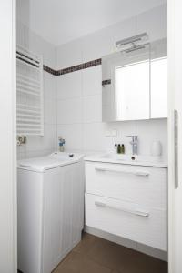 Ein Badezimmer in der Unterkunft KH Apartments Universitaet
