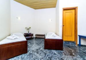 A bed or beds in a room at Ambrosia Hotel