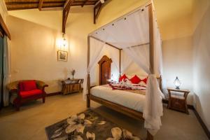 Cama ou camas em um quarto em Villa Aashaya Ubud