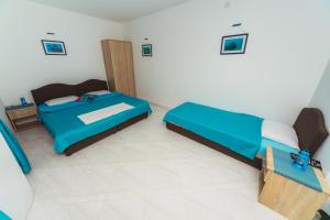 A bed or beds in a room at Apartments Suster