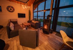 """A seating area at Ferienhaus """"Chalet100"""""""