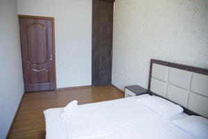 A bed or beds in a room at Modern and nice apartment in the heart of Yerevan
