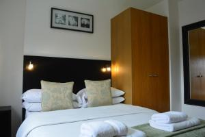 A bed or beds in a room at Studios2Let - North Gower