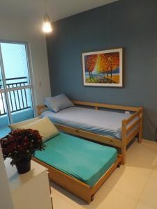 A bed or beds in a room at Smart Residence Flat