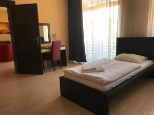Postel nebo postele na pokoji v ubytování Apartmán Paradise