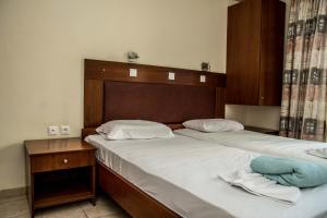 A bed or beds in a room at Sevastos Studios
