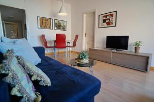 A television and/or entertainment center at Barcelona4Seasons II