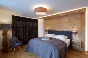 Postel nebo postele na pokoji v ubytování Alpenchalet Vils