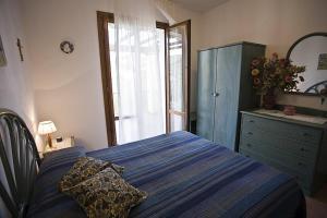 Letto o letti in una camera di Villetta Olivo 5