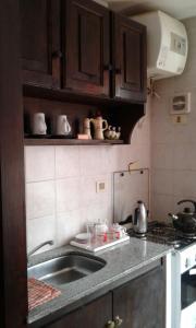 Una cocina o zona de cocina en Lp