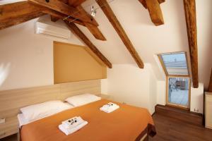 Un ou plusieurs lits dans un hébergement de l'établissement Residence U Černé Věže České Budějovice