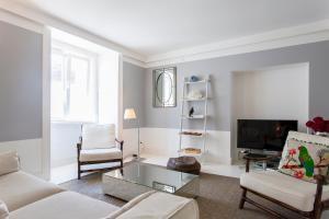 Coin salon dans l'établissement Baixa Deluxe Apartments by Altido
