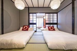 เตียงในห้องที่ Zebrahouse Morinomiya