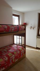 A bunk bed or bunk beds in a room at Residenza Casa Rosada