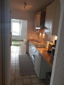 Küche/Küchenzeile in der Unterkunft Ferienwohnung Leo