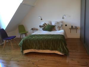 Een bed of bedden in een kamer bij LODGE-CAEN